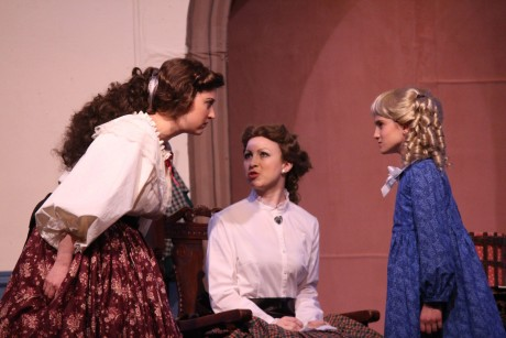 The Sisters square off. From left to right: Jo (Heather Norcross), Meg (Emily Golden), Amy (Sophia Manicone). Photo courtesy of Aldersgate Church Community Theatre.