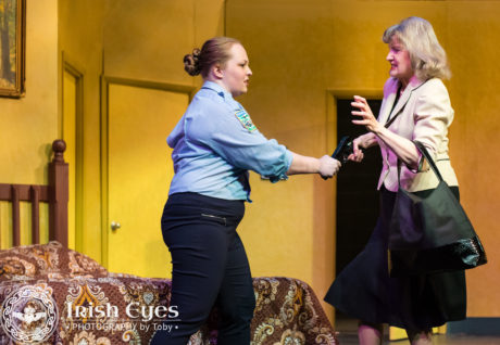 Officer Billie Dwyer (Lynley Peoples) tries to keep Mary Meekly (Marilyn Pifer) from taking her gun. Photo by Irish Eyes Photography by Toby.