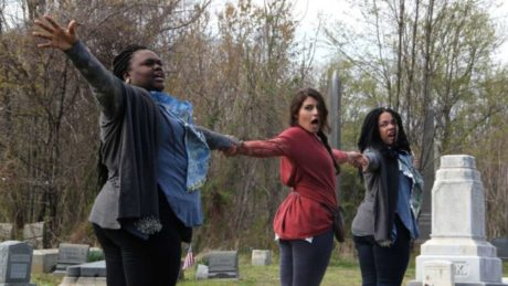 Performers of Renegade Theater Company's rendition of Beowulf rehearse among the tombstones of Mount Moriah Cemetery. Photo by Emma Lee.