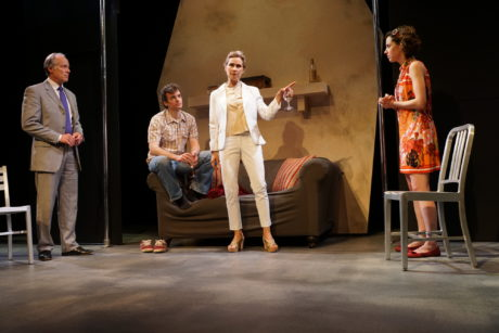 Cast members: Greg Wood, Nate Washburn, Susan Riley Stevens, and Laura Chaneski in Passage Theatre's White Guy on the Bus. Photo by Michael Goldstein.