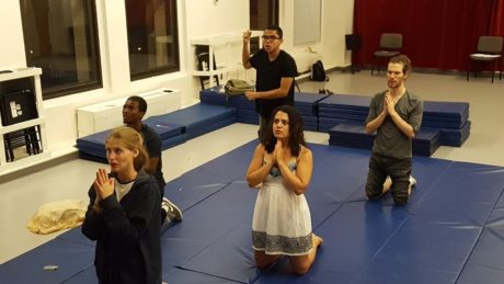 'The Theatre Made in Paradise' rehearsal photo with cast praying.