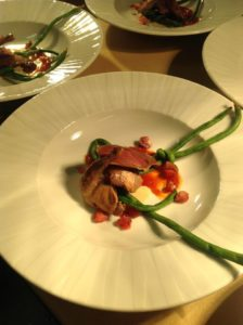 Smoked squab breast and confit leg, gently cooked long beans, cornbread sauce, vodka macerated cherries, and pearls of hot honey. Photo courtesy of Azure's facebook page.