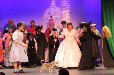 Lucia LaNave as Dorothy Stacy Cricket as Glinda the Good Witch of the North, and Melanie Jennings-Bales as the Wicked Witch of the West, and Princess -aka Mutt Mutt (Toto). Photo by Michelle Macdonald.