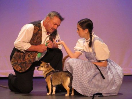 Larry Keeling (The Wizard of Oz) and Princess -aka Mutt Mutt (Toto) and Lucia LaNave (Dorothy). by Michelle Macdonald.