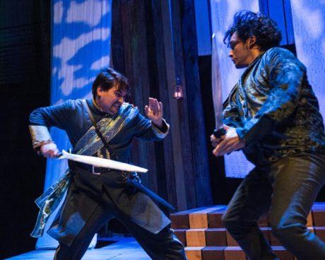 Passed over for promotion, Iago (Jose Guzman) plots a revenge against Othello and promises to win Othello's wife for Roderigo (Elliott Kashner). Photo by Teresa Castracane.