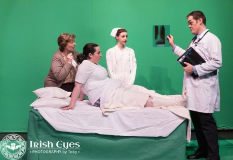 A mother (Anne Hilleary), her injured child (Bridgette Saverine), nurse Jacie (Caity Brown) and Doctor (Stephen T. Wheeler) in a scene from the hospital soap opera. Photo by Irish Eyes Photography by Toby.