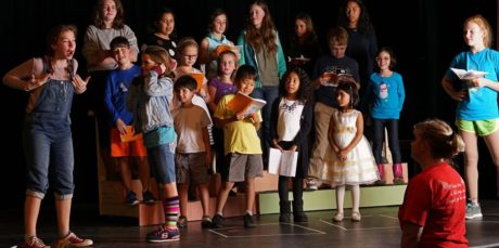 Director Liz Mykietyn (foreground) rehearses a scene with the highly talented group of young people who comprise much of the cast of The Best Christmas Pageant Ever which opens December 9th at the James Lee Community Center Theater. Photo by Rob Cuevas, Providence Players
