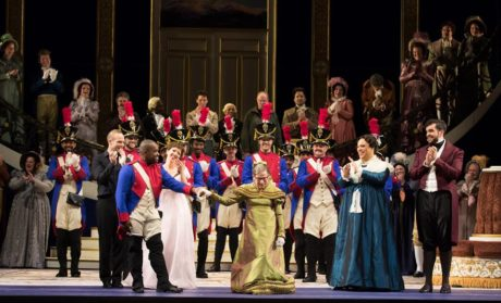 Tenor Lawrence Brownlee escorts Justice Ruth Bader Ginsburg at the curtain call. Photo by Scott Suchman.