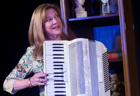 Janet Constable Preston as Claire attempting to play the accordion. Photo by Harvey Levine.