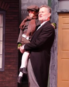 Tony Gilbert (Scrooge) and Josh Gordon (Tiny Tim). Photo by Doug Olmstead.