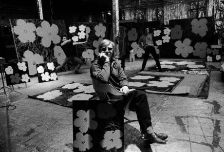 Andy Warhol, Gerard Malanga, and Philip Fagan at The Factory, New York, NY, 1964. Photo by Ugo Mulas. Courtesy and ©Ugo Mulas Heirs. All rights reserved. Andy Warhol Artwork . ©The Andy Warhol Foundation for the Visual Arts, Inc. / Artists Rights Society (ARS), New York.