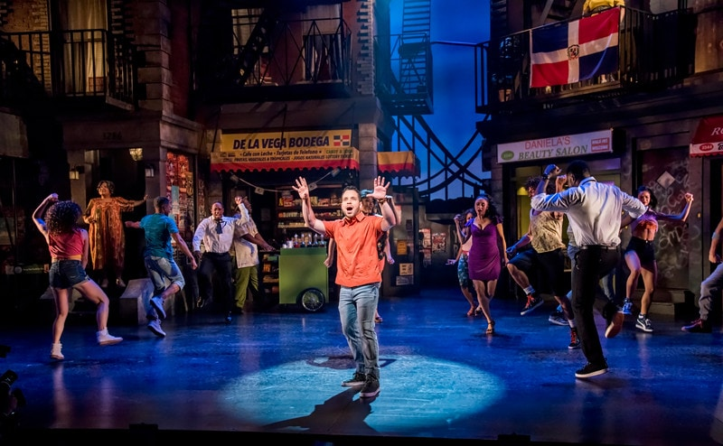 Robin de Jesús and the ensemble of In the Heights, co-produced by Olney Theatre Center and Round House Theatre. Photo by Stan Barouh.