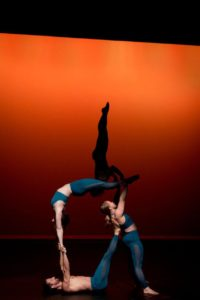 Julia Quigley (with Anthony Oliva, Kiersten Van Houten and Lessie Skiba Longstreet) performs a partner balancing act. Photo by Dani Pierce Steuber.