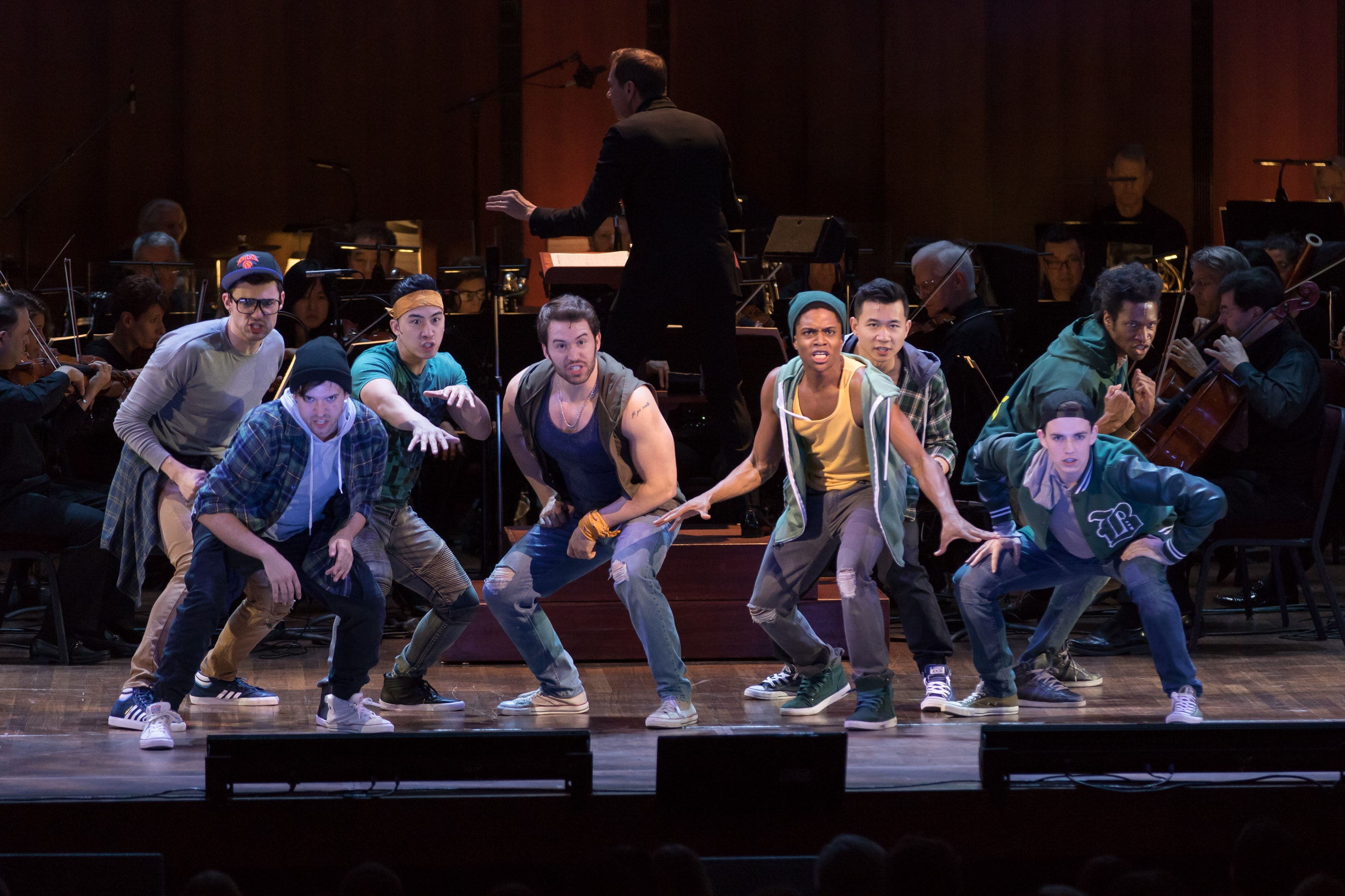 The Jets, backed by the NSO Pops Orchestra, in West Side Story. Photo by Scott Suchman.