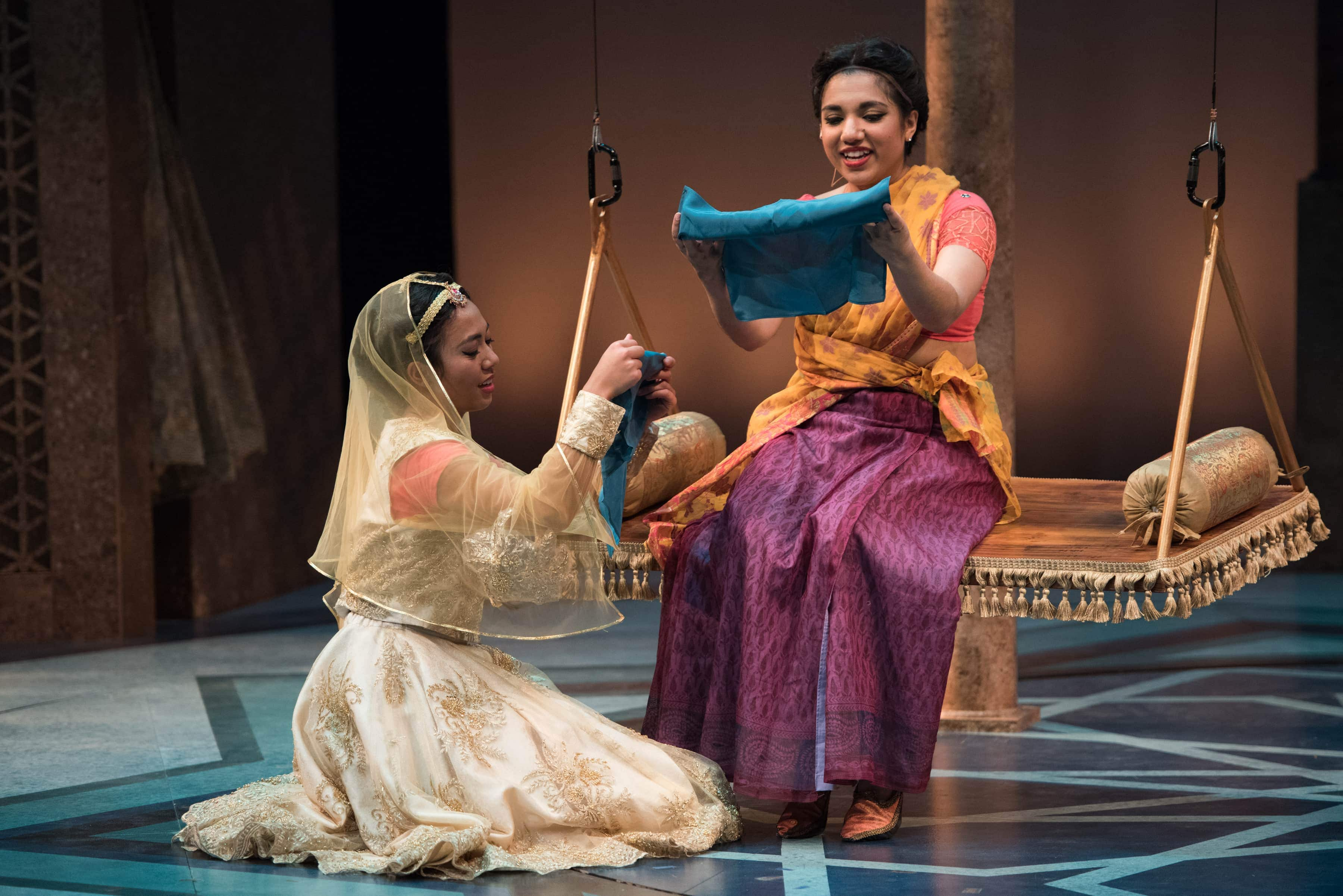 Having switched clothes, Princess Razia and Rani exchange scarves. (L-R: Alexandra Palting, Anjna Swaminathan). Photo by Margot Schulman.