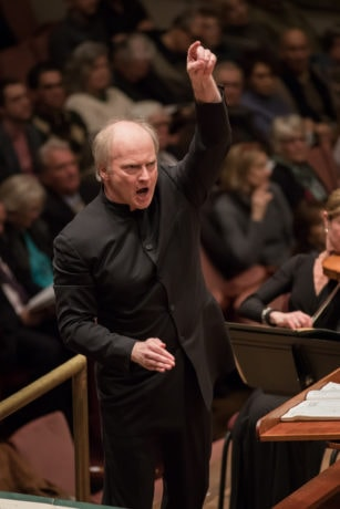 """Maestro Noseda conducts the NSO performing Verdi's """"Requiem"""" in March of 2018. Photo by"""