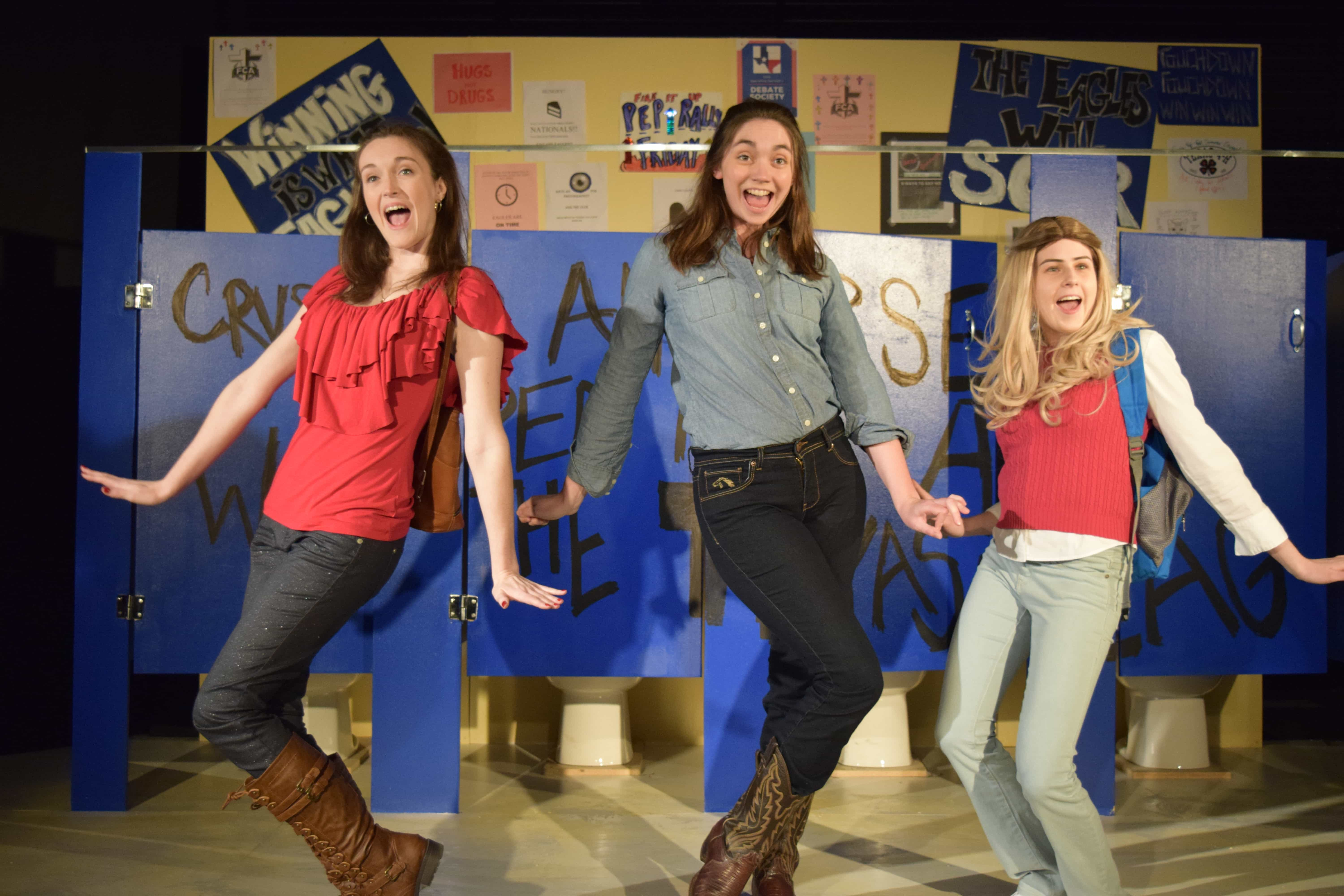 Jess (Kira Burri), Tammy (Brooke Friday) and Sammy (Claire Derriennic) are excited by some gossip on the bathroom wall. Photo by Kanea McDonald.