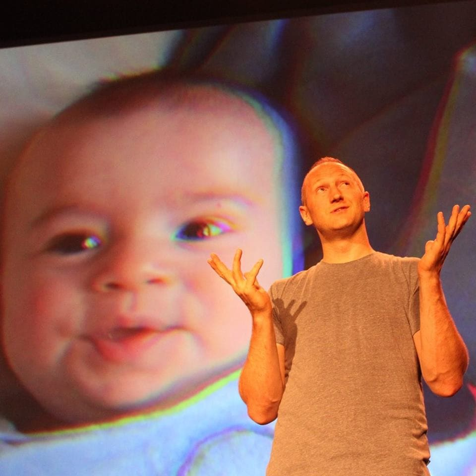 Baba Brinkman, with a projection of his son Dylan. Photo courtesy of the artist.