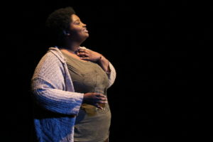 """Natalie Dent in """"Hello, baby. I miss you."""" Directed by Christen Cromwell and written by Tatiana Nya Ford. Photo courtesy of Fells Point Corner Theatre."""