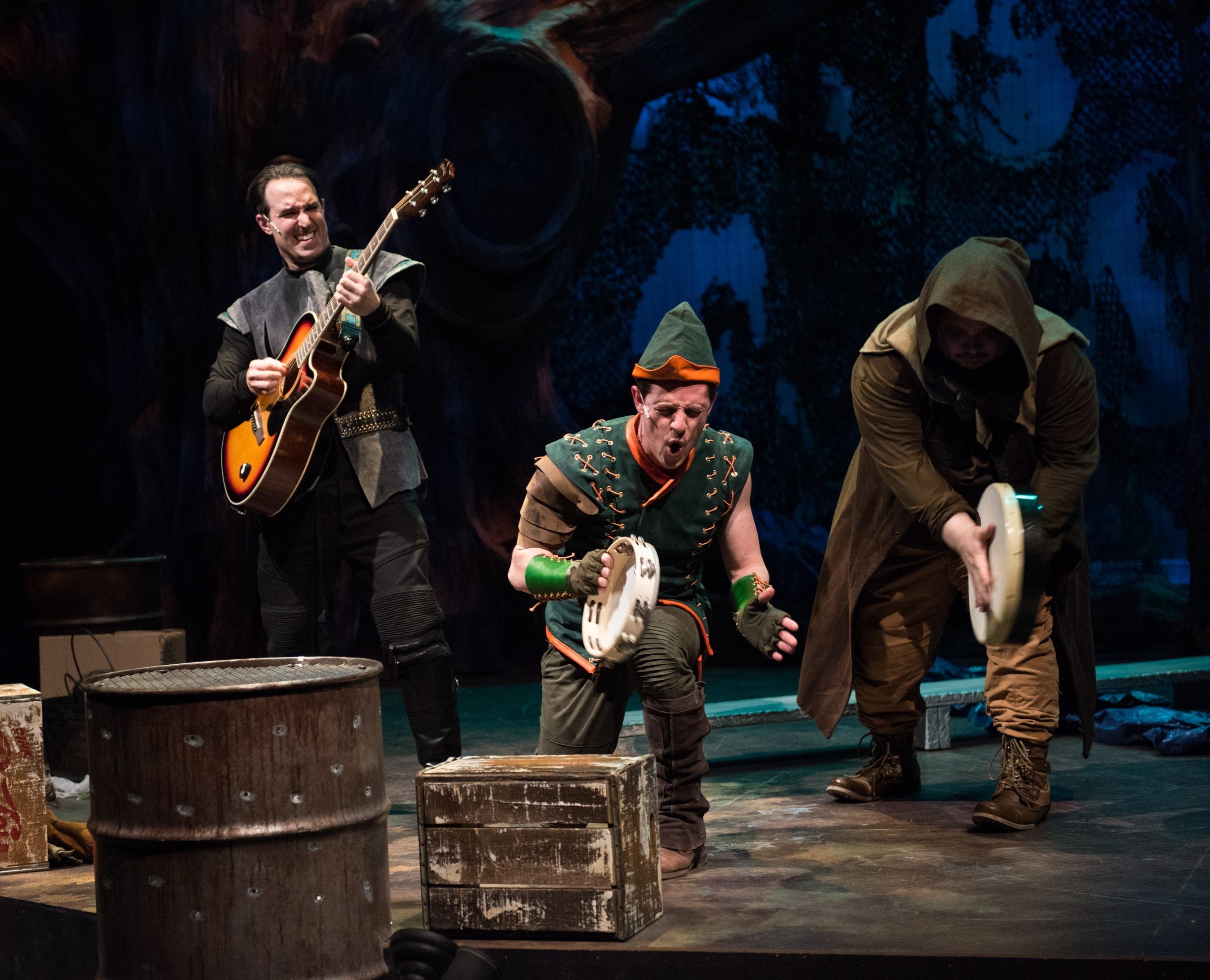 Robin Hood rocks out with his Merry Men. [L-R: Nick DePinto, Christopher Dinolfo, Jon Jon Johnson]. Photo by Margot Schulman.