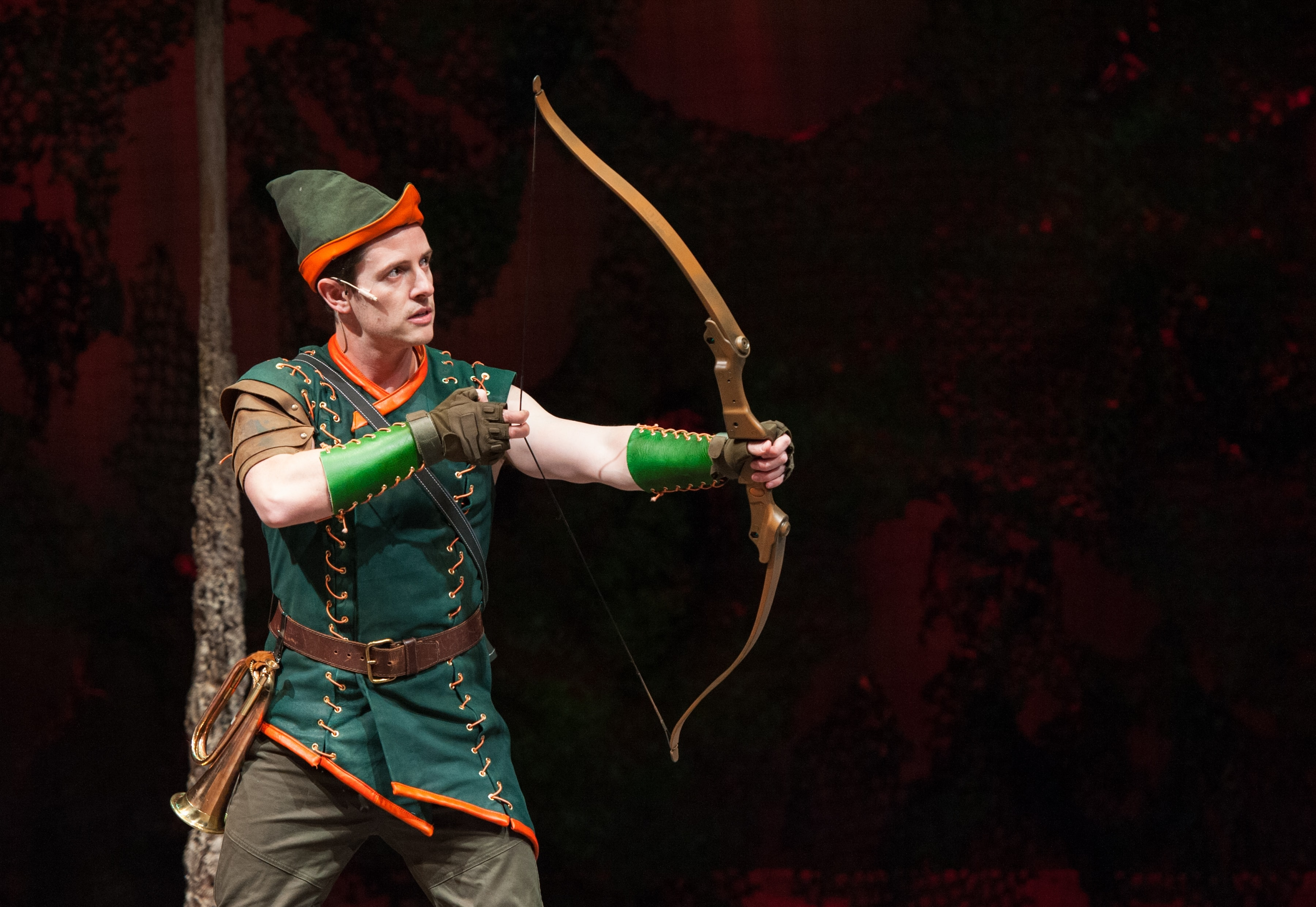 The hero Robin Hood draws his bow. [Chris Dinolfo]. Photo by Margot Schulman.