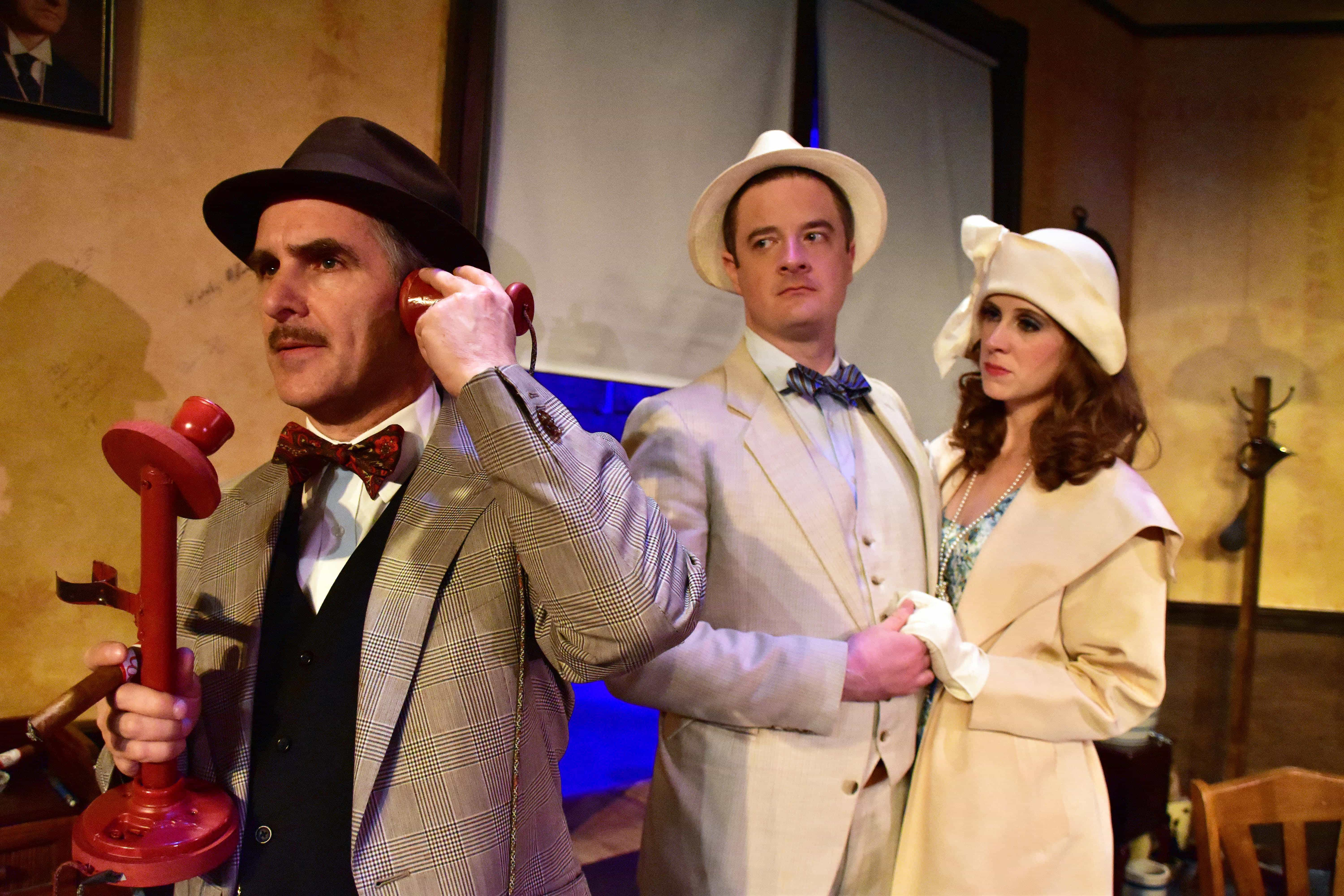 L to R: David Whitehead as Walter Burns, Jaclyn Robertson as Peggy Grant and Chuck O'Toole as Hildy Johnson in the Providence Players production of The Front Page at the James Lee Community Center Theater. Photo by Chip Gertzog.