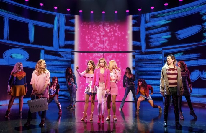 Erika Henningsen, Ashley Park, Taylor Louderman, and Kate Rockwell (left to right, in pink), with the cast. Photo by Joan Marcus.