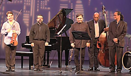 The National Chamber Ensemble takes a bow at the end of its performance, Today's Classical and Jazz Masters. Photo by Robert Jansen.