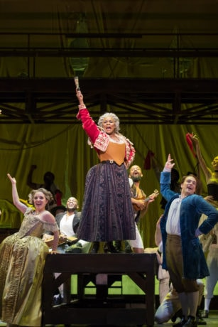 Soprano Emily Pogorelc (Cunegonde), mezzo-soprano Denyce Graves (The Old Lady) and tenor Alek Shrader (Candide) in the Washington National Opera's production of Candide. Photo by Scott Suchman.