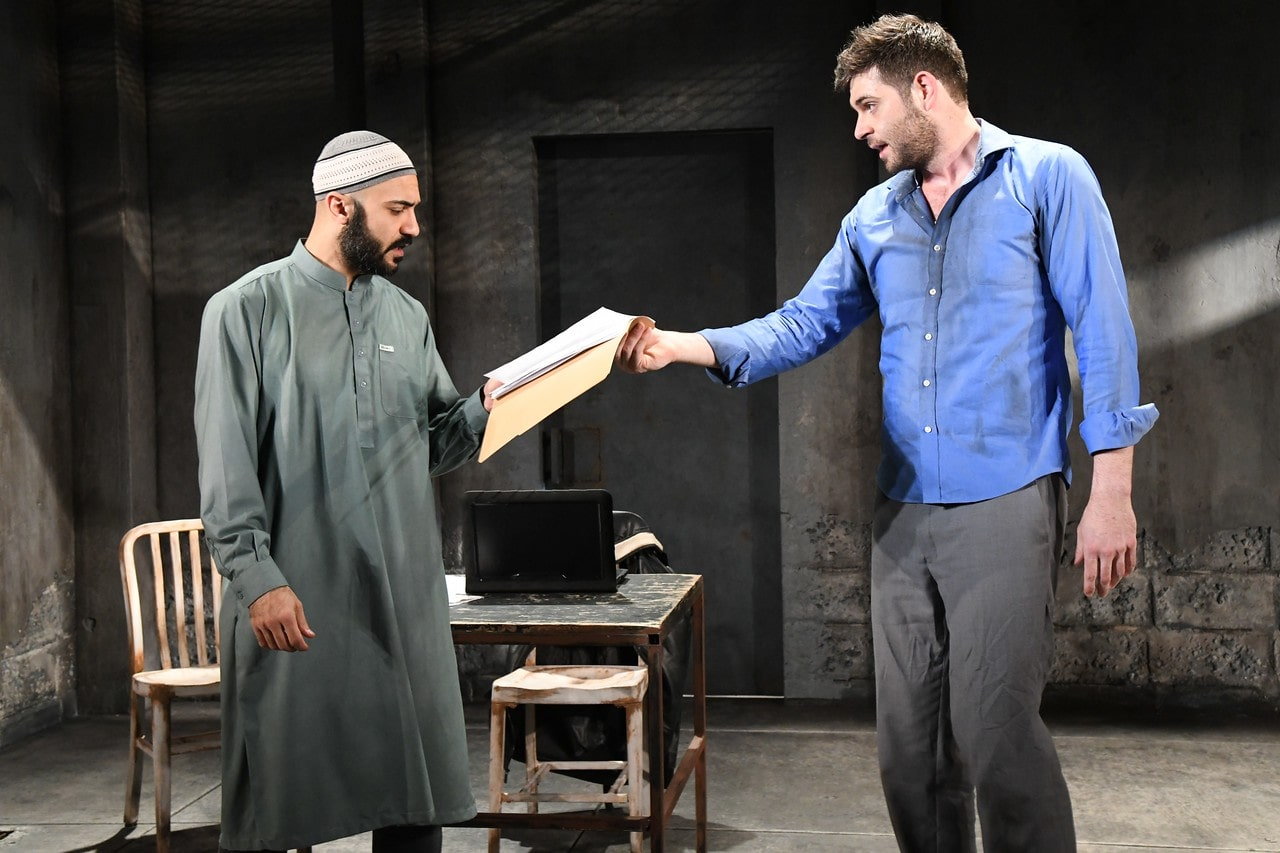 Maboud Ebrahimzadeh and Thomas Keegan as Bashir and Nick Bright in THE INVISIBLE HAND at Olney Theatre Center. (Photo: Stan Barouh)
