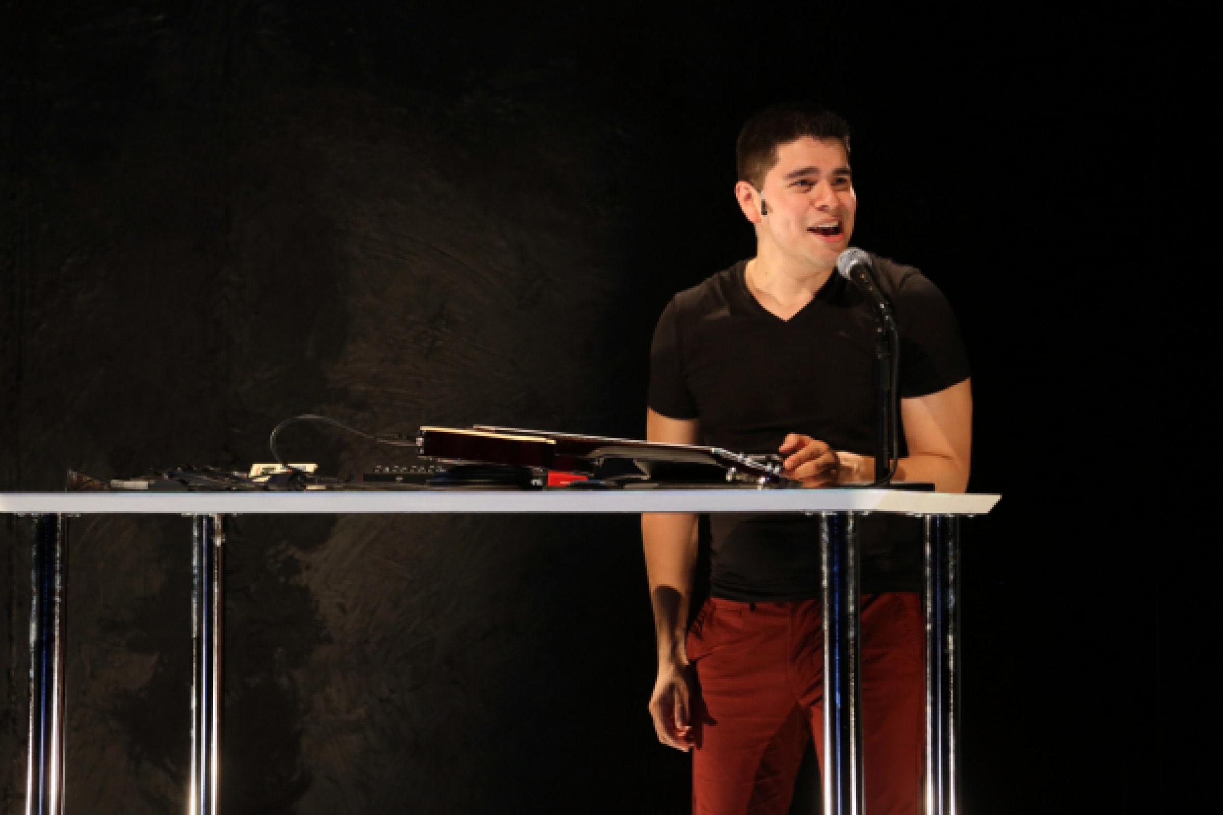 Brian Quijada mixes sound during his one-man show, Where Did We Sit On The Bus?, now playing at 1st Stage Tysons as part of the Logan Festival of Solo Performances. Photo by Gerry Goodstein.