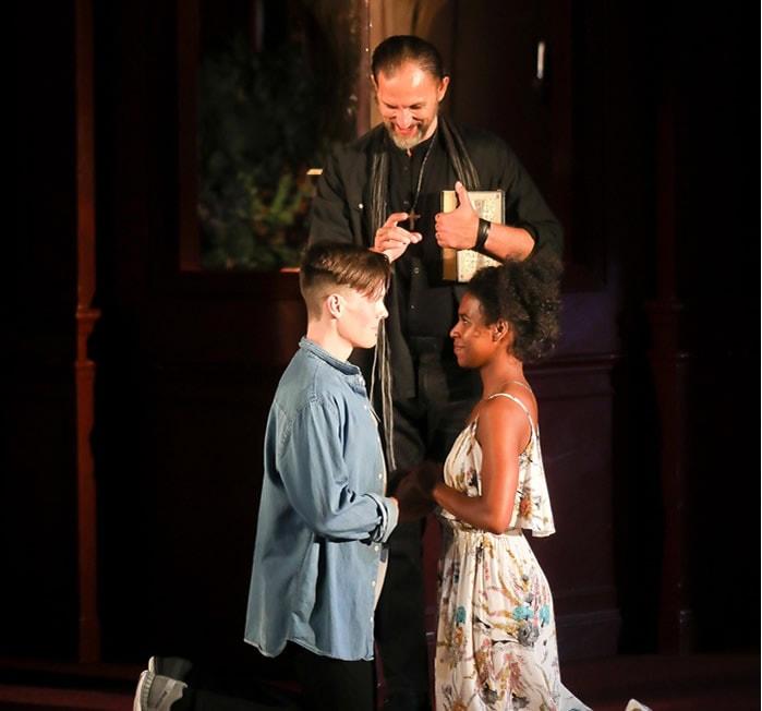 Ron Menzel as Friar Laurence, Danaya Esperanza as Juliet and Sam Lilja in Romeo & Juliet. Photo by Tony Powell.
