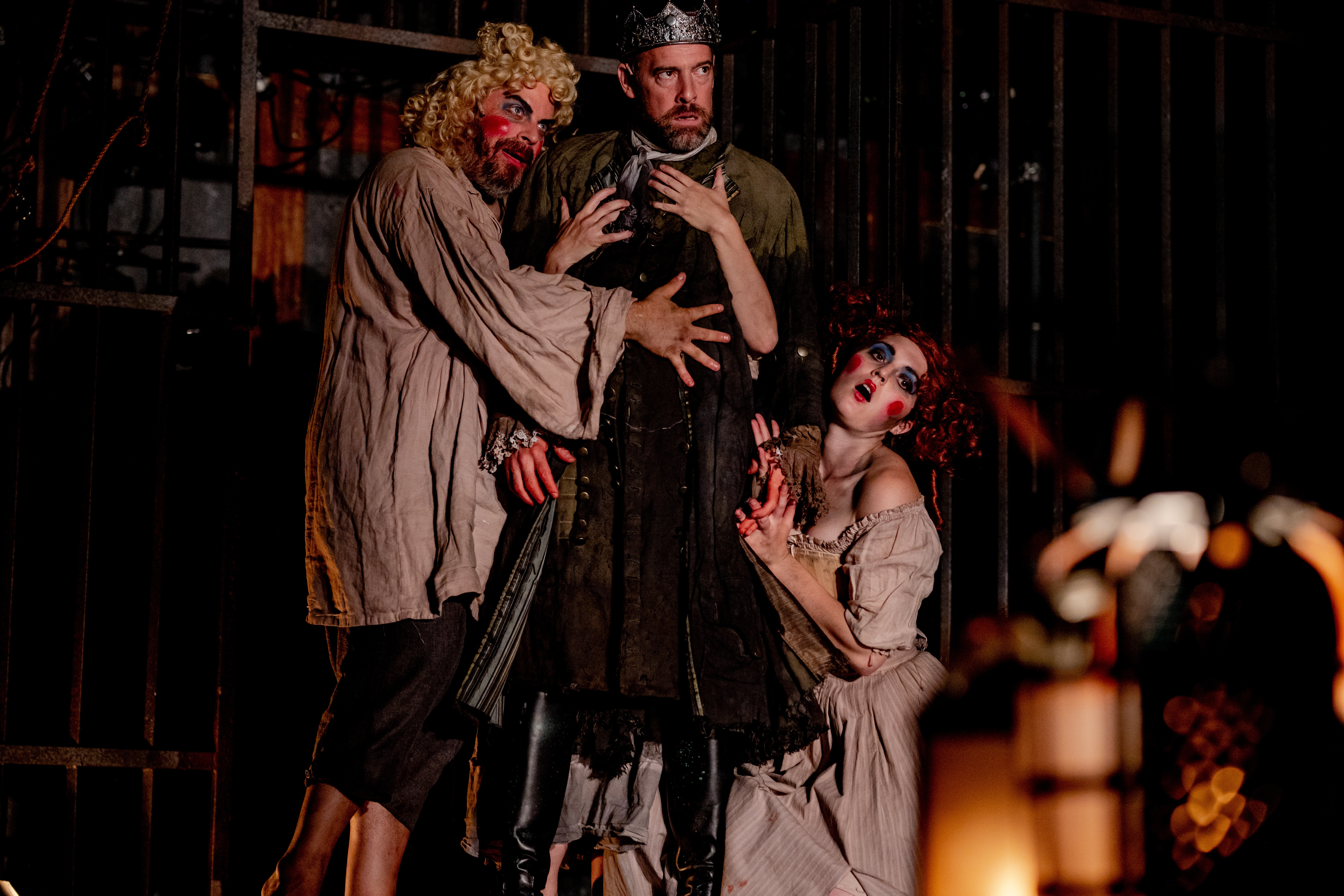 Macbeth (Ian Merrill Peakes, center) is flanked by witches (Ethan Watermeier and Rachael Montgomery) in Folger Theatre's production of Macbeth. On stage September 4–23, 2018. Photo by Brittany Diliberto.