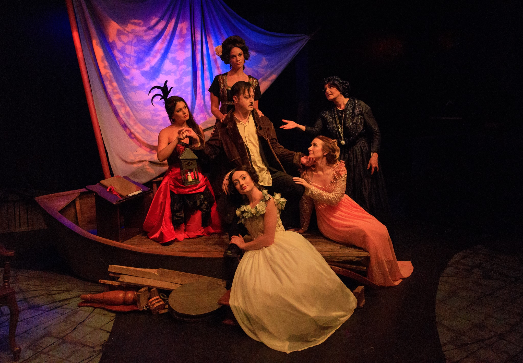 Clockwise from Center: Katherine Riddle as Mother, Jennifer Pagnard as Muddy, Erin Granfield as Elmira, Sara Hurley as Virginia, Stephen Gregory Smith as Edgar Allan Poe, and Mary Kate Brouillet as the Whore in Nevermore. Photo Credit: Keith Waters/Kx Photography