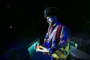 Matthew Schleigh as Singer in The Caucasian Chalk Circle. Photo by Daniel Schwartz.