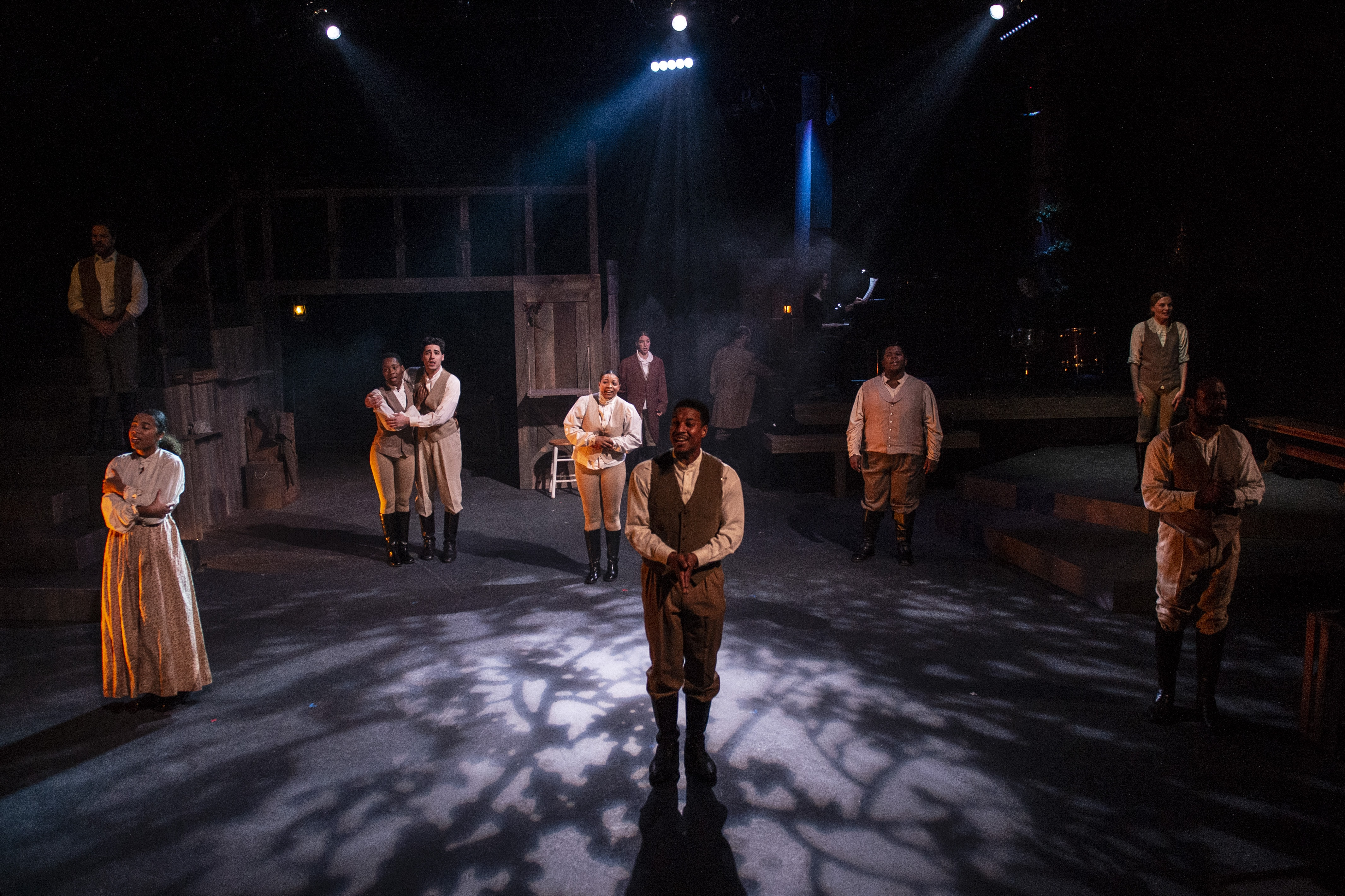 """(l-r) Russell Rinker, Karma Price, Billie Krishawn, Ayanna Hardy, Suzy Alden, Gary L. Perkins III, Joshua Simon, Demitrus Carter, Rebecca Ballinger, and V. Savoy McIlwain in """"A Civil War Christmas"""" at 1st Stage. Photo by Teresa Castracane."""