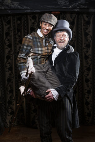 Constance Swain (Tiny Tim) and Patrick Earl (Ebenezer Scrooge) in American Shakespeare Company's 2018 production of A Christmas Carol. Photo by Lauren Parker.