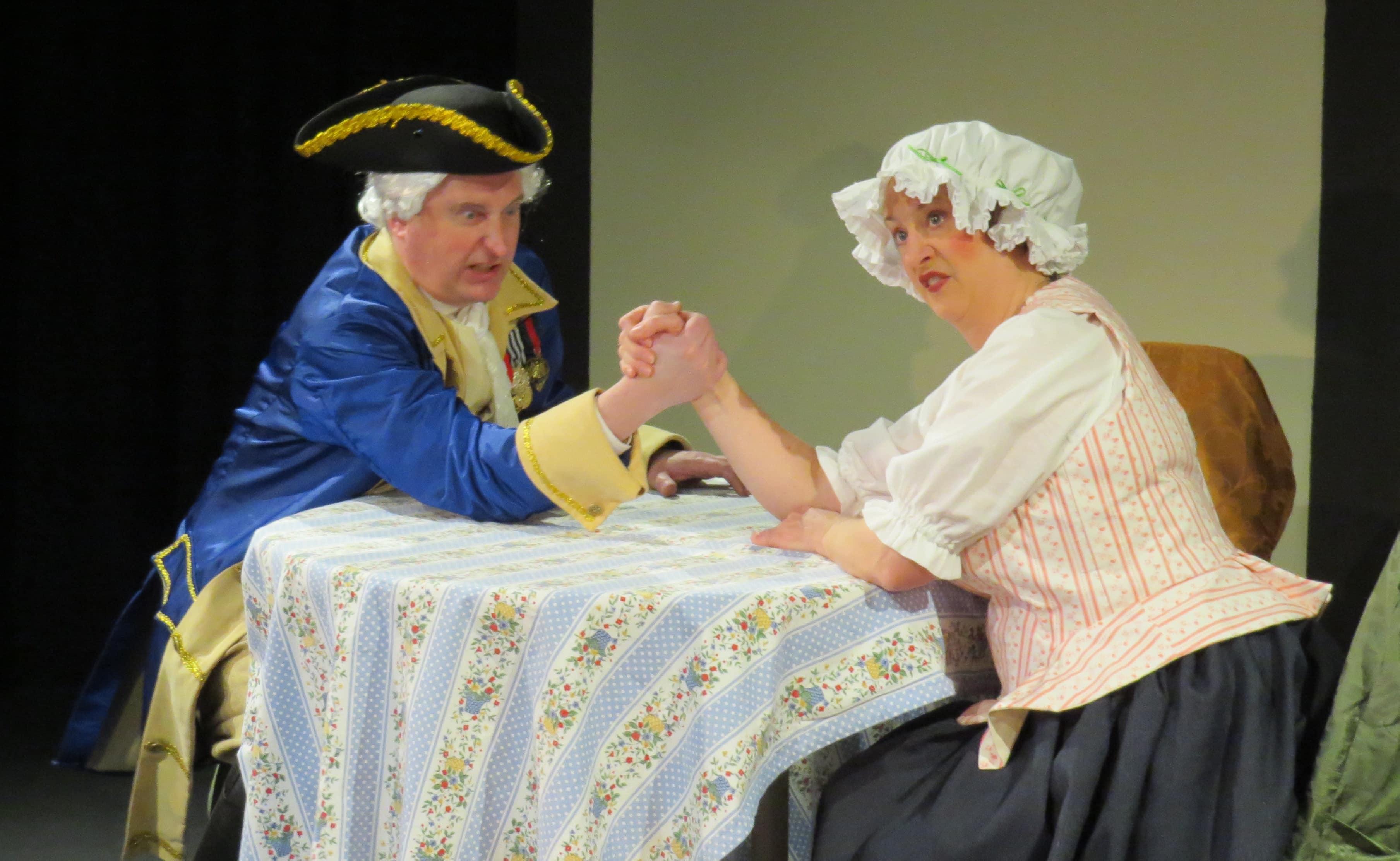 Freytag (John Morogiello) negotiates with Frau Schmidt (Rebecca A. Herron). Photo by Elizabeth Kemmerer.