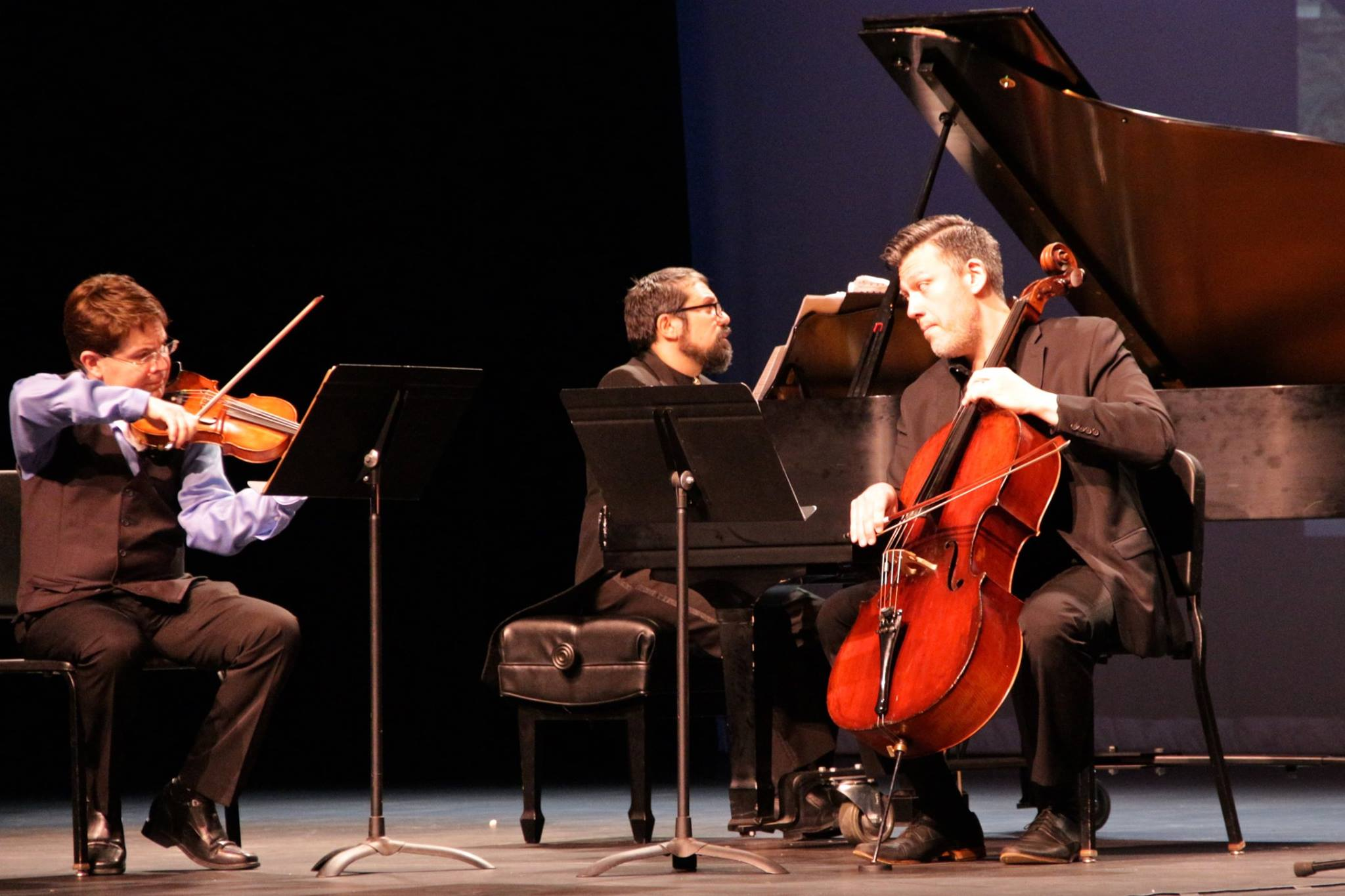 L-R: Leonid Sushansky (violin), Carlos Cesar Rodriguez (piano) and Sean Neidlinger (cello) of the National Chamber Ensemble perform 'The Viennese Classics.' Photo by Angela S. Anderson.