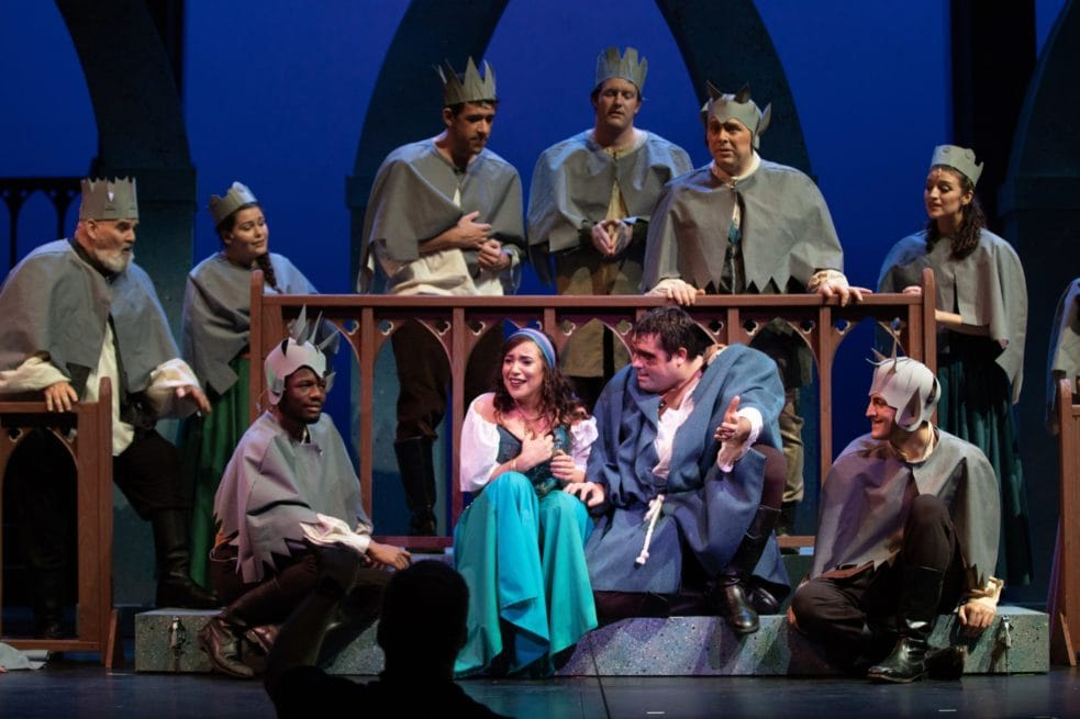Alex Bryce as Quasimodo, Adelina Mitchell as Esmerelda, surrounded by members of the ensemble. Photo by Peter Hill.