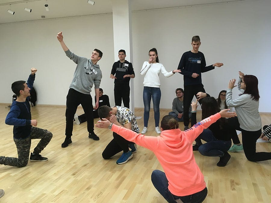 The Voices of Now ensemble in Zagreb begin the process by learning tableau skills. Photo courtesy of Arena Stage.