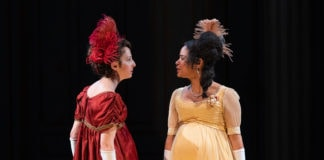 Rebekah Brockman as Becky Sharp and Maribel Martinez as Amelia Sedley in 'Vanity Fair' at the Shakespeare Theatre Company. Photo by Scott Suchman.