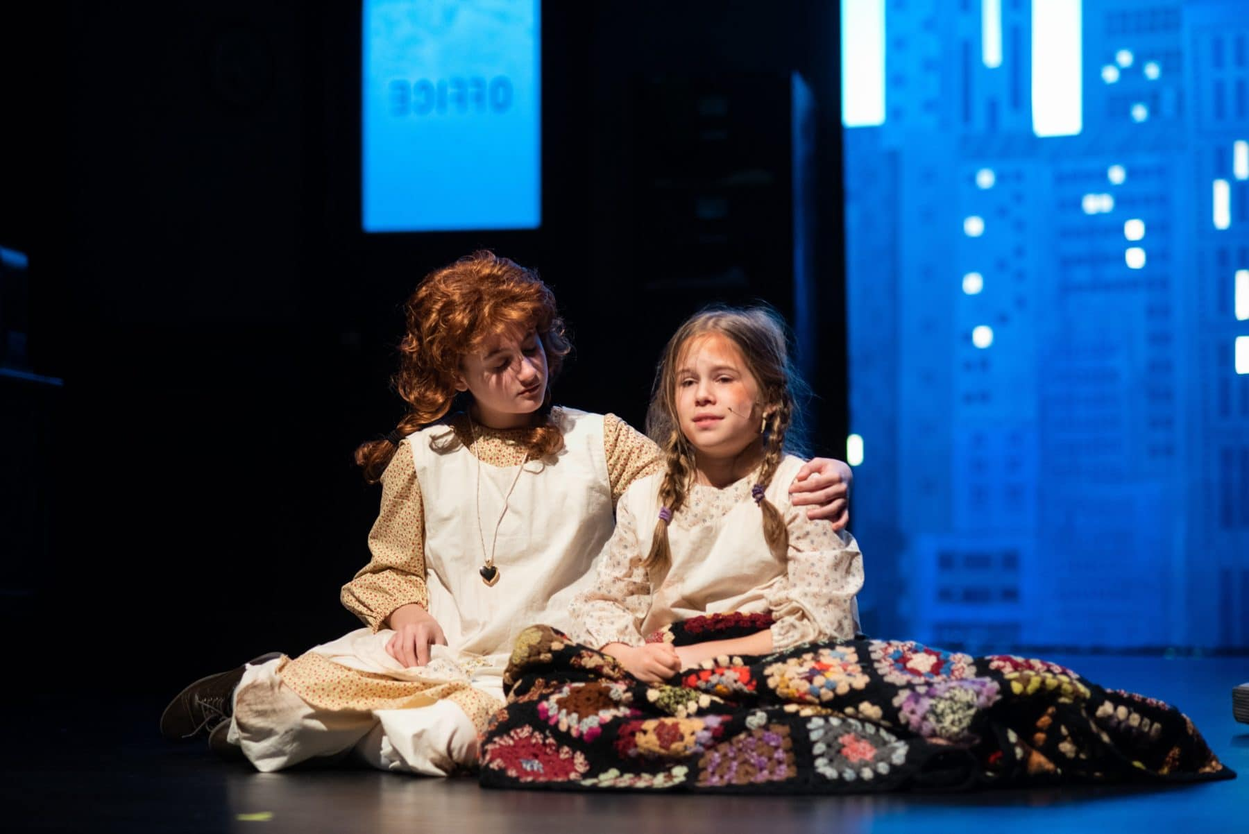 Kylee Hope Geraci (Annie) comforts Jane Keifer (Molly) in Reston Community Players' 'Annie.' Photo by Jennifer Heffner Photography.