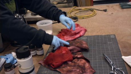 STC Properties Assistant Rebecca Williams tests fabric dye. Photo courtesy of Shakespeare Theatre Company.