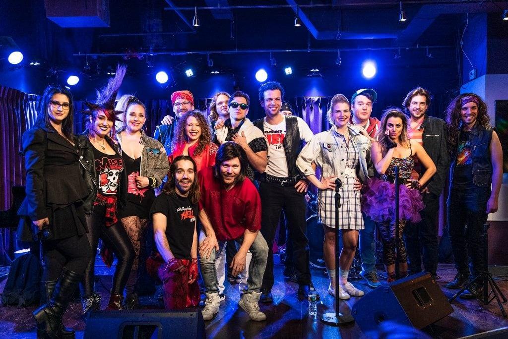 Rachel Klein (left), Sean Matthew Whiteford (kneeling, left front), and the cast. Photo by Matt Yeager.