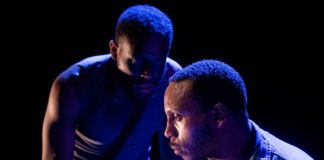 Vaughn Ryan Midder as the Black Rat and Clayton Pelham, Jr. as Bigger Thomas in Mosaic Theater Company's production of 'Native Son.' Photo by Stan Barouh.