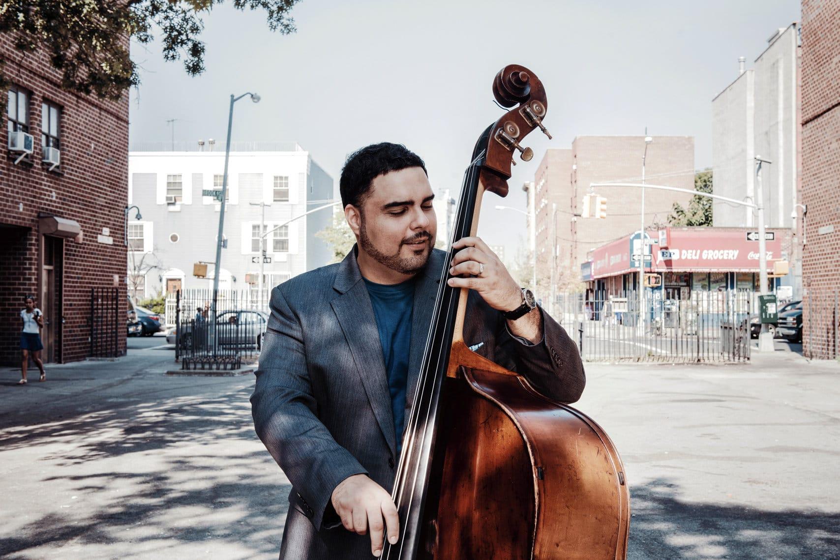 Bassist Carlos Henriquez. Photo by Lawrence Sumulong.