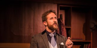 Adam Ressa (Watson) in City of Fairfax Theatre Company's production of 'The (curious case of the) Watson Intelligence.' Photo by Rebecca Kalant-Kelling.