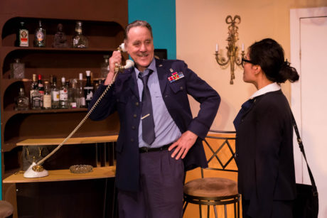Colonel Brooks (Sandy Irving) meets FBI agent MK (Joy Liu) in Greenbelt Arts Center's production of 'The Honey Trap.' Photo by Kimberly Curren.