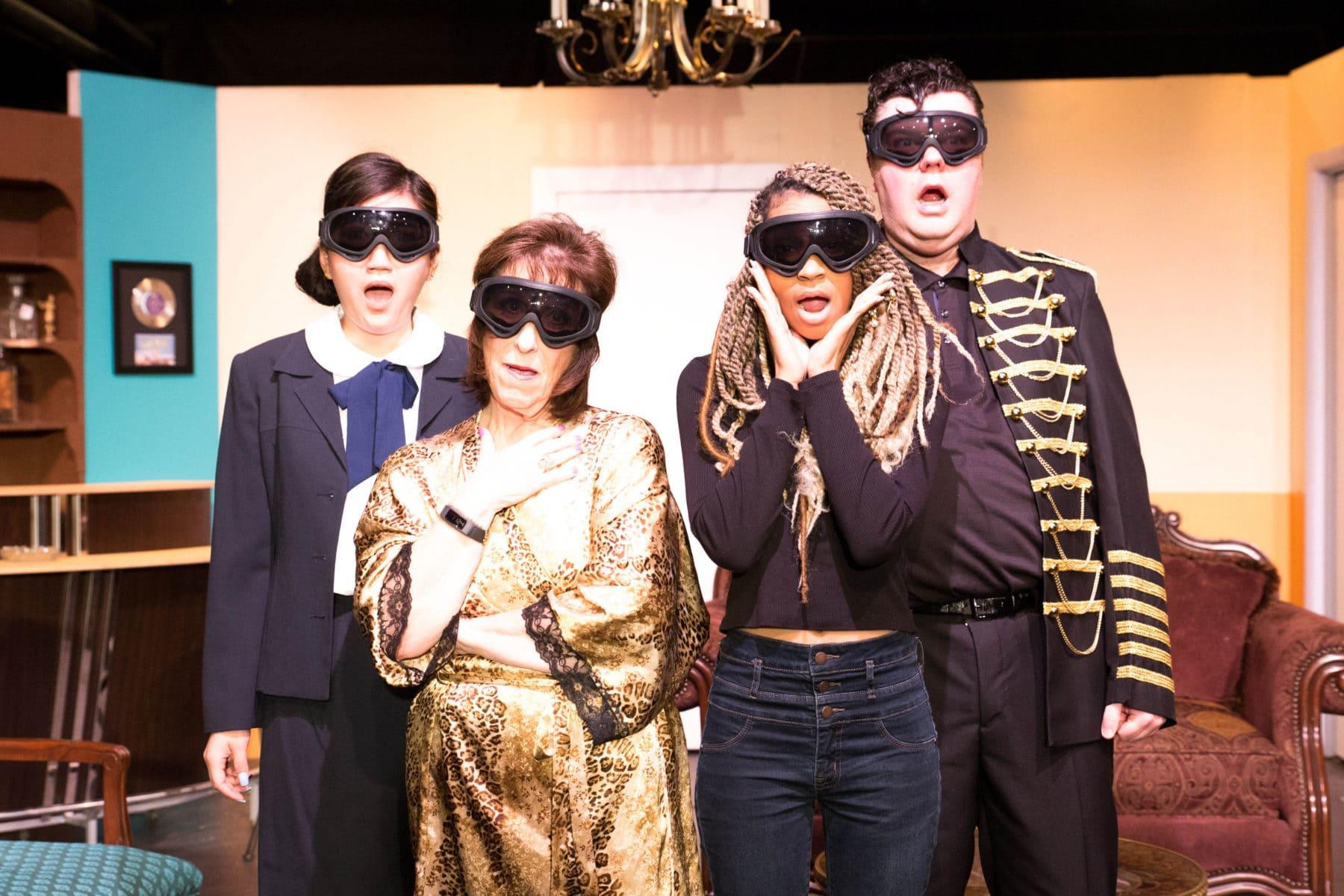 MK (Joy Liu), Beatrice (Joy Gerst), Flo (Tawny Rucker), and Mort (Brian Stepowany) watch the bomb blast in Greenbelt Arts Center's production of 'The Honey Trap.' Photo by Kimberly Curren.